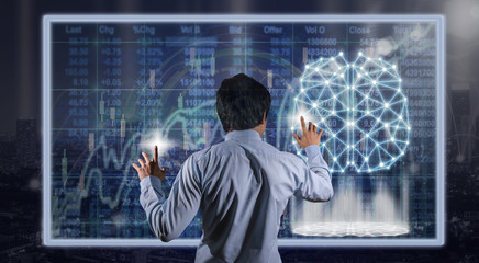 Back side of Businessman hand touching the technology digital virtual screen over the Stock market chart background, business innovation concept