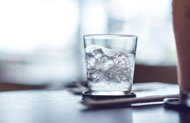 glass with ice on the table.cold filter effect