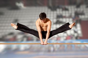Gymnast competing on high bar