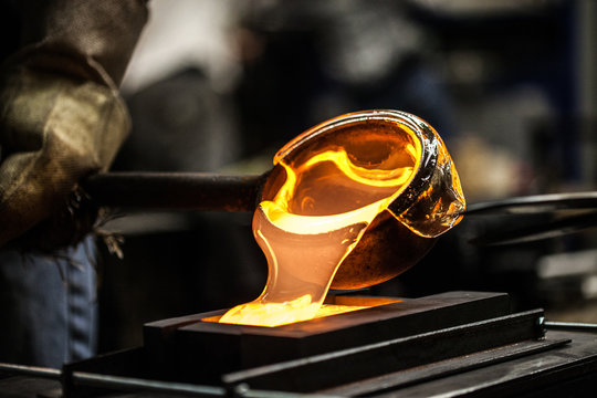Pouring Melted Glass into Graphite Mold