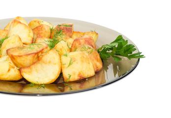 Fried potatoes on the dark glass dish