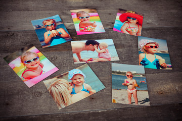 Photo album remembrance and nostalgia in summer journey trip on wood table, vintage and retro style