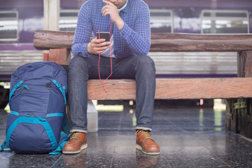 man traveler with backpacker look searching location in phone, travel concept