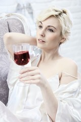 Daydreaming woman drinking wine