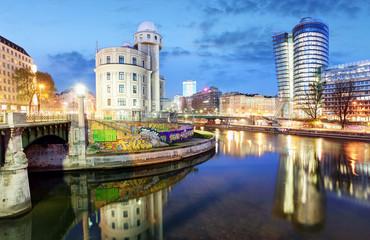 Austria, Modern Vienna with Danube canal at night, Wien
