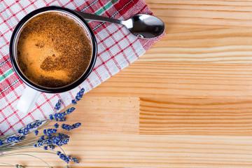 Coffee in a vintage metal mug, lavender and spoon.