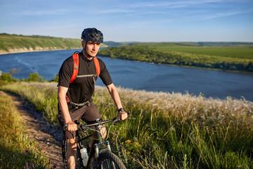 Traveler has adventur on meadow on riverside