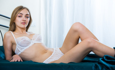 Charming girl relaxing in seductive frillies