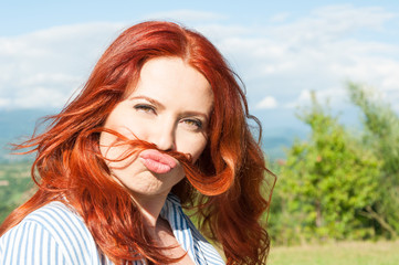 Funny woman shows moustache hair and having fun