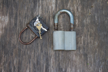 Old rusty castles with keys for an old house in the village. Old wooden table background.
