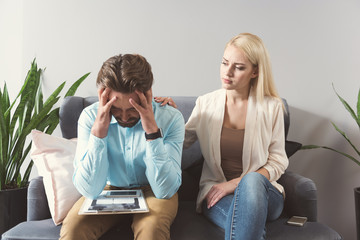 Frustrated young bearded guy and woman waiting for interview results