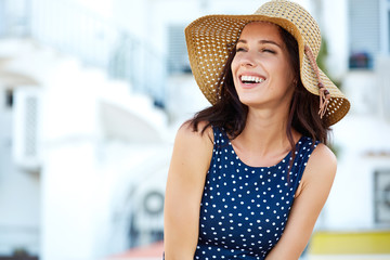 Smiling beautiful young woman in summer hat