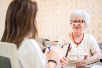 Psychotherapist talking to senior patient.