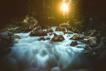 Wall Mural - Scenic Alpine Waterfall Sunset