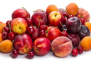 Heap ripe fruit on white