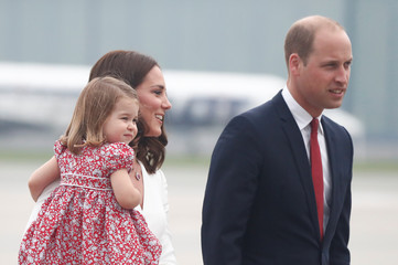 Prince William, the Duke of Cambridge, his wife Catherine, The Duchess of Cambridge and Princess Charlotte arrive at a military airport in Warsaw