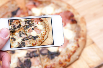 taking a photo of food on a mobile phone
