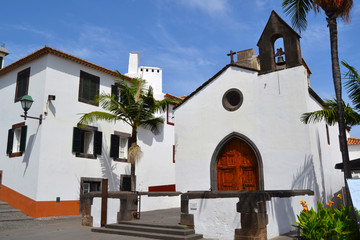 White church building with blue sky on coast of Madeira island, Portugal .
