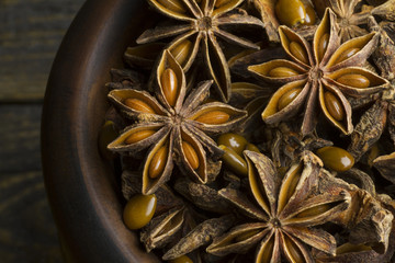 Star anise on a wood bowl