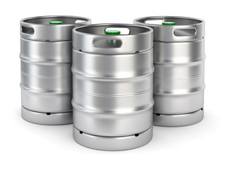 Metal beer kegs on white background