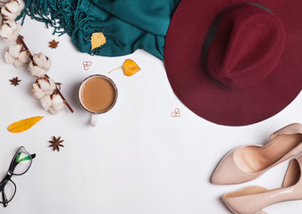 Woman's autumn accessories on white background