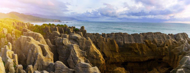 Panoramic image of beautiful Pancake Rocks and Blowholes , located in Paparoa National Park , Punakaiki , South Island of New Zealand