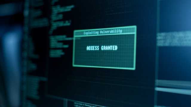 Display Showing Stages of Hacking in Progress: Exploiting Vulnerability, Executing and Granted Access.