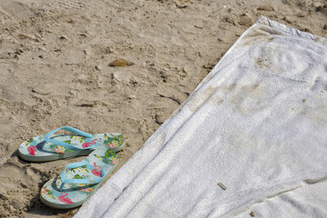 Flip-flop and beach towel