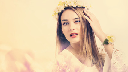 Beautiful young woman on a pink floral background