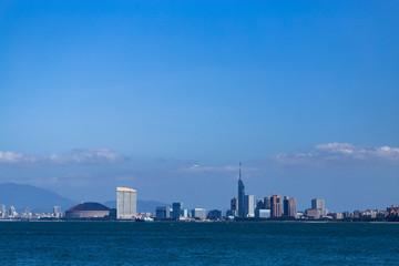 Fukuoka city scape and landmarks, Fukuoka tower and Fukuoka dome over ocean.   Wall mural