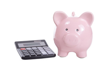 Calculator with pink piggy bank on white