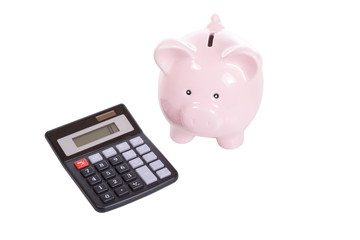Little pink piggy bank with calculator on white