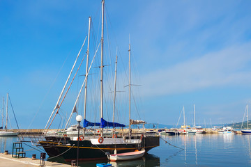 Yachts, sailing boats and pleasure boats are moored in marina of Balchik city in black sea coast at Bulgaria