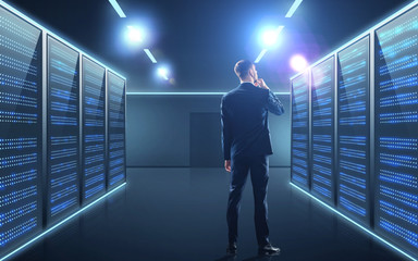 businessman over server room background
