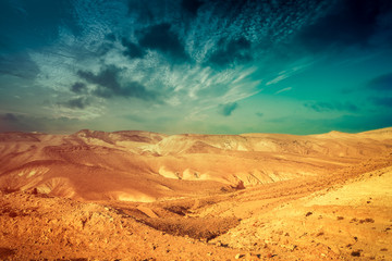 Aluminium Prints Drought Mountainous desert with colorful cloudy sky. Judean desert in Israel at sunset