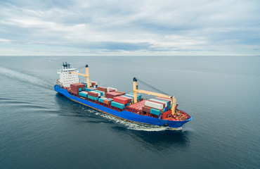 Container vessel sailing in open sea