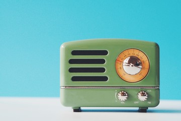 Vintage radio over blue color background,copy space