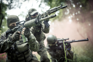 Officers on exercises in forest