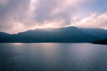 Scenic view of foggy and cloudy lake Ashi, Mount Fuji Area, Hakone, Japan