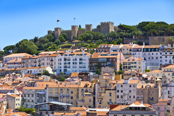 The visible profile of the Castle of Sao Jorge (Castelo de Sao Jorge) overlooking the historical centre of Lisbon city, Portugal