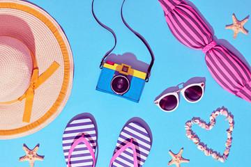 Beach Sunny Set. Fashion Summer Accessories, Film Camera, Stylish Swimsuit Bikini, Trendy Sunglasses, fashion Hat. Hot Vibes. Sweet Bright summer color. Creative Fun Art. Retro Design camera on Blue