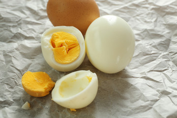 Tasty hard boiled eggs on parchment paper. Nutrition concept