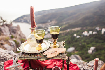 Two glasses of wine on a background of mountains