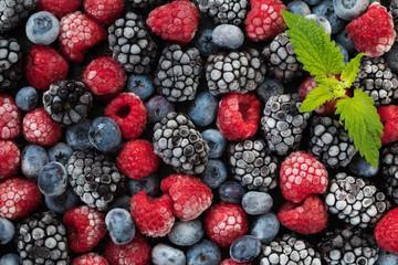 Assorted frozen berries background. Top view of background