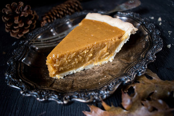 Pumpkin Pie from the side in elegant fall setting
