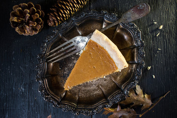 Pumpkin Pie slice with fork from above in fall setting