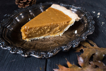 Pumpkin Pie slice in elegant fall setting
