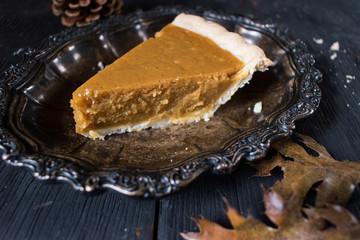 Pumpkin Pie slice in elegant fall setting