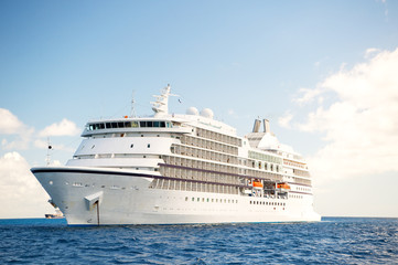 Large luxury white cruise ship liner at sea