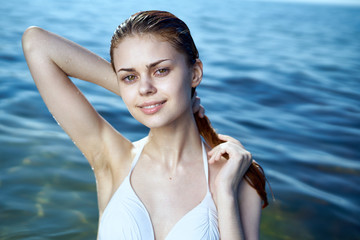 Young beautiful woman resting while the sea, beach, summer, sun, vacation